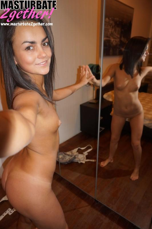 Petite girl naked in the mirror.
